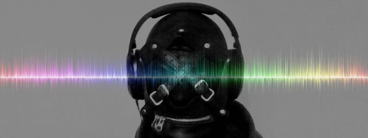 BDSM Gimp wearing headphones listening to podcast